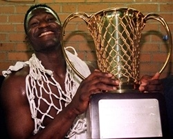 Dominique Wilkins poses with the 1996 European Cup trophy.