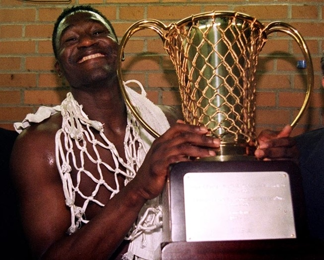 Dominique Wilkins poses with the 1996 European Cup trophy