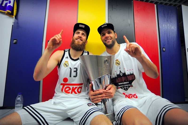 Sergio Rodriguez and Felipe Reyes hug the trophy.