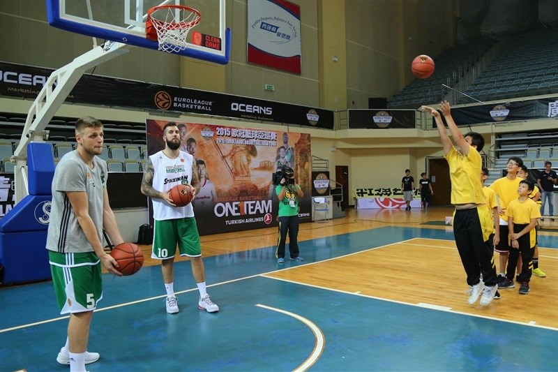 Charalampoulos and Raduljica of Panathinaikos - One Team activity  at Chinese school in Macao - World Tour 2015 - EB15